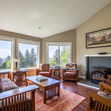 Real estate interior photo of living room with ocean view